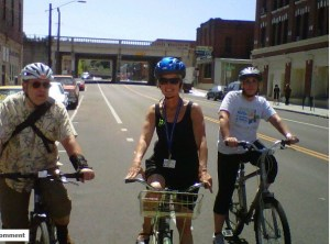 Mary Verner (center) rides on the bike lane on Jefferson, part of the new downtown Spokane loop created in 2011.