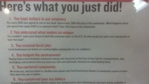 What it means to buy local: Close-up from a sign in Auntie's Bookstore, Spokane. 1) You kept dollars in our economy. 2) You embraced what makes us unique. 3) You created local jobs. 4) You helped the environment. 5) You nurtured community. 6) You conserved your tax dollars.