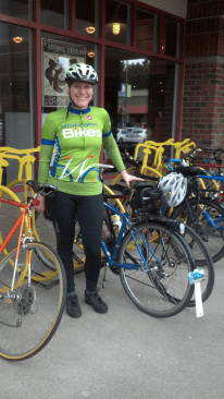 A rare shot: Me wearing a bike jersey! I love our WA Bikes jerseys -- how handy that our logo uses one of my favorite colors. Parked in this fun bike rack on a trip to Honey Bear Bakery in Lake Forest Park, WA.