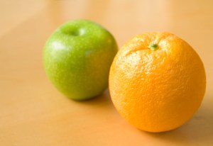 Whole green apple and whole orange