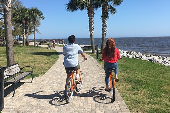Couple on Orange Bikes Neptune Park Pier St. Simons Island