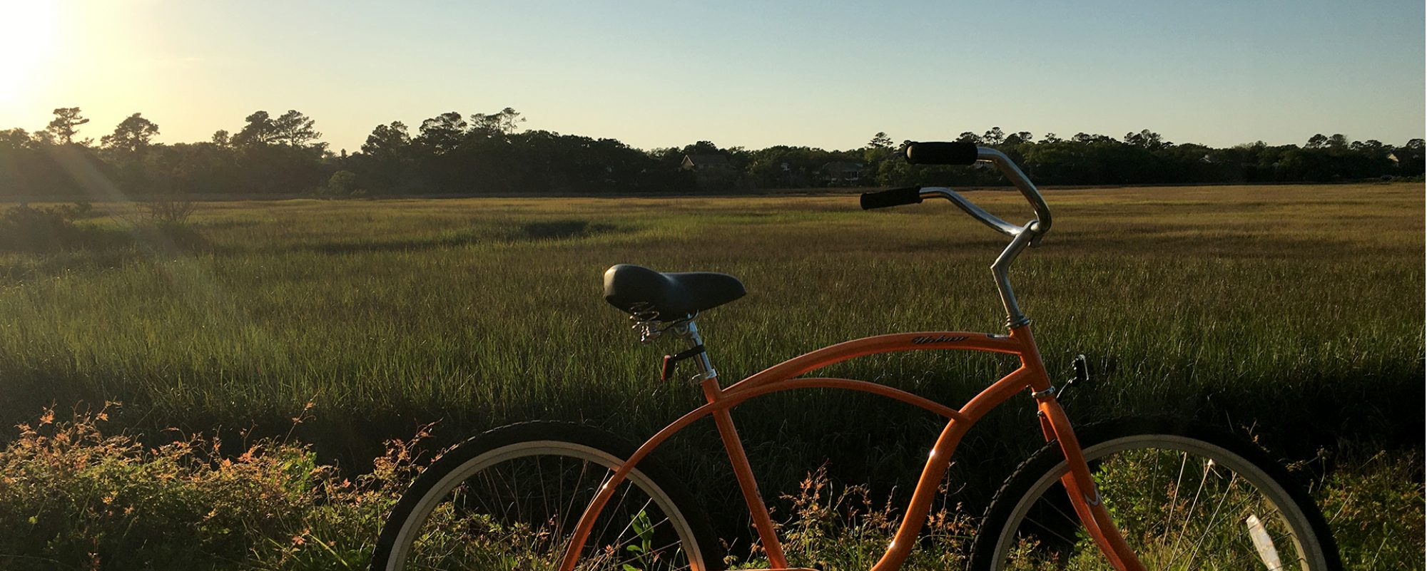 Photo: orange bicycle beside marsh on St. Simons Island