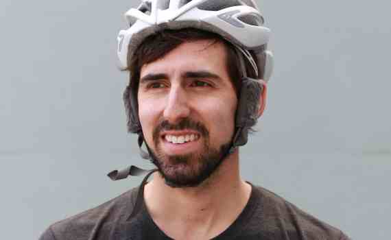 Someone smiling wearing a bicycle helmet with Cat Ears
