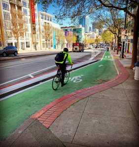 A green protected bike lane on market street in san francisco