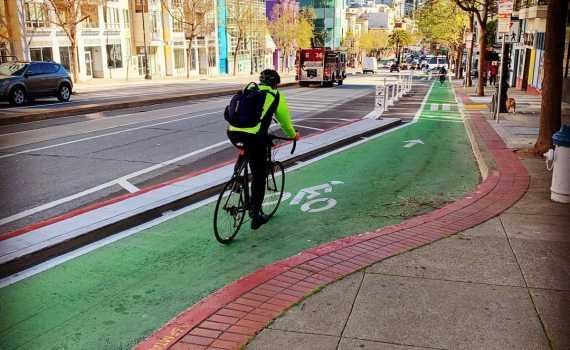 A green protected bike lane on market street in san francisco