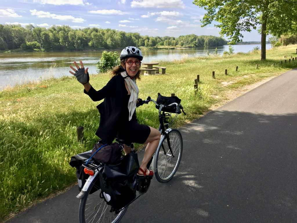 bike riding and waving in the Loire Valley, France