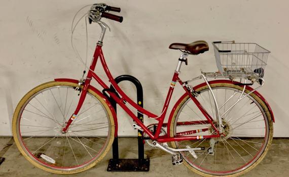 A Public bike locked in a parking garage