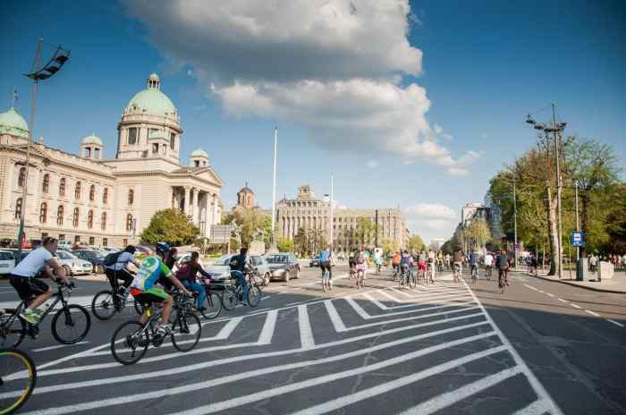 Critical mass taking over the streets of Belgrade Serbia and a beautiful partly cloudy day.