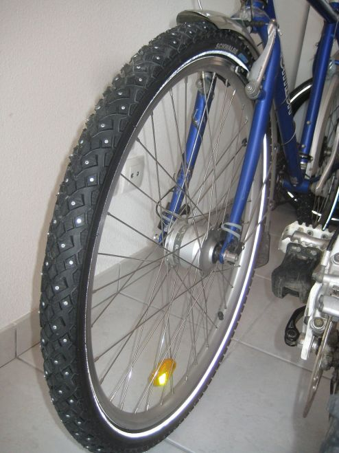 A winter tire covered with studs to help with traction in ice and snow.