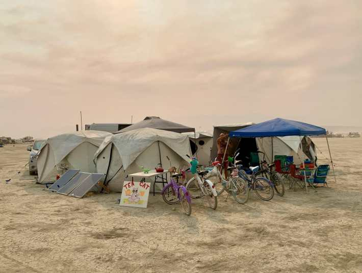 a burning man camp setup with bicycles out front