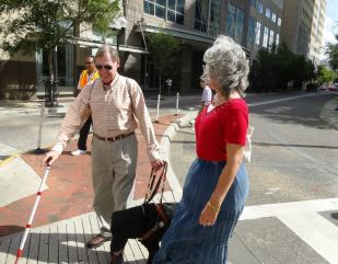 Orlando Mayor Buddy Dyer crosses the street blindfolded
