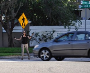 This driver didn't yield to the BFF pedestrian at E. Michigan St. & Cayman Way in Orlando