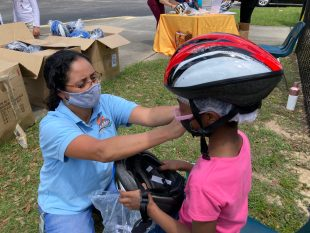 Pinewood Students Receive Bicycles and Helmets
