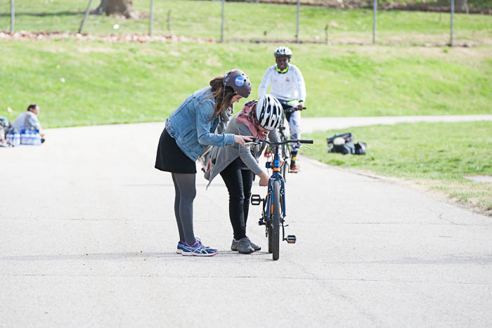 BikeWalkKC Education Manager, Maggie, teaching Noor how to ride a bike. She only ever rode tricycles in Iraq. She was riding two wheels in no time!