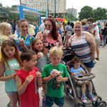 Family enjoys Pride cookies at PrideKC Kick-Off Celebration