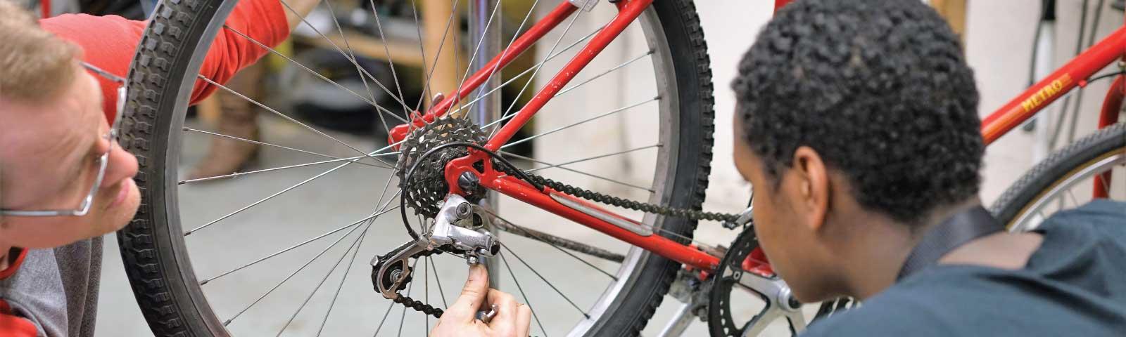 Job Skills Training teach bike repair to young adults