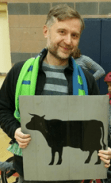 Educator holding a sign as part of the obstacle course