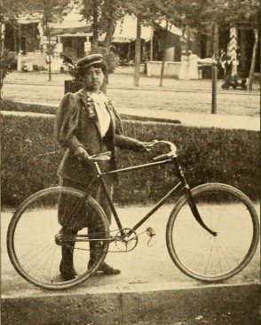 Black female cyclist Kittie Knox poses with her bicycle in the 1890s