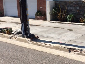 The curb divider is literally falling apart; photo by Carol Detrick.