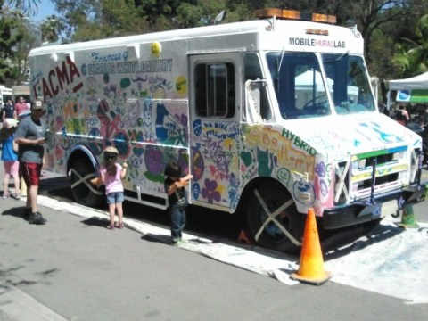 Children and adults took advantage of the opportunity to add their artwork to this van.