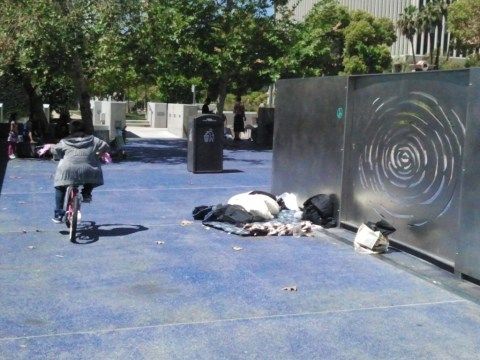 A homeless man sleeping behind the memorial shows we still have a long way to go to live up to RFK's ideals.