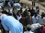 @TariqSiyal1 Home minister Sohail Anwer Siyal & Ammar Khan Bughio distributing ration in flood Affected people in relief camps 3