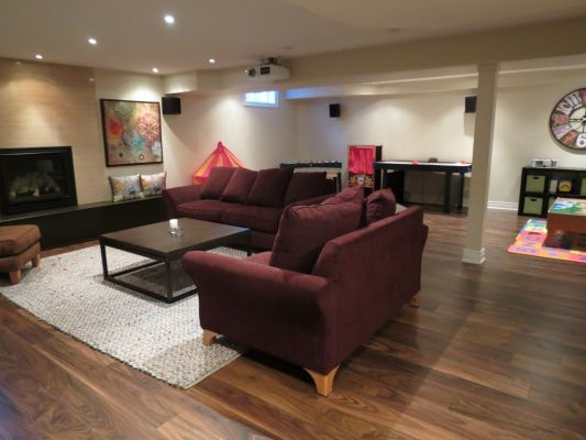 Custom Basement Living area by Bildam
