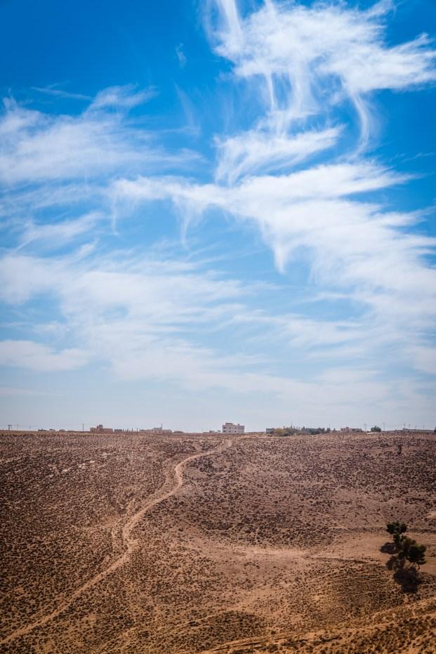 blue-sky-clouds-barren-landscape-jordan