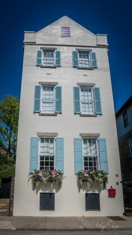three-story-white-house-shutters