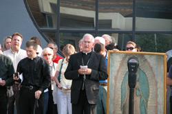 Archbishop Kurtz, D.D., praying at the abortion mill in Louisville, KY
