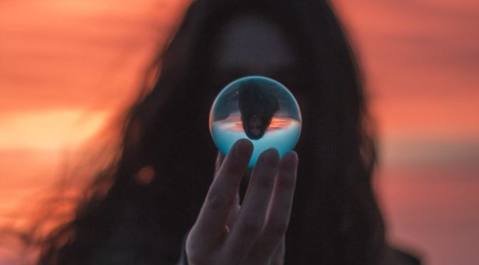 Woman holding a crystal sphere