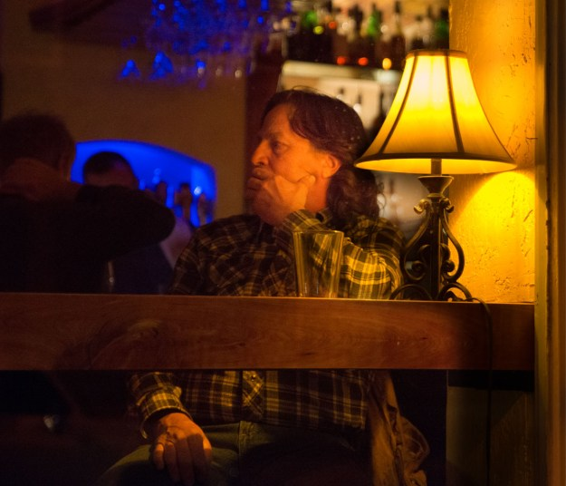 A patron sits lost in thought at a downtown Flagstaff cocktail lounge.