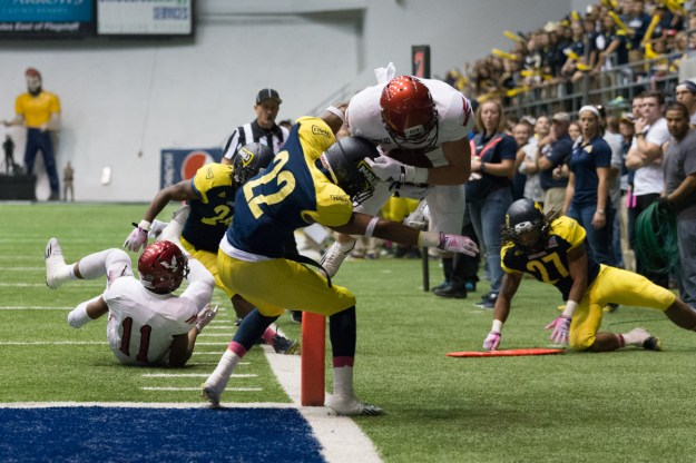 Eastern Washington's Cooper Kupp skies over NAU defender Marcus Alford to score a touchdown