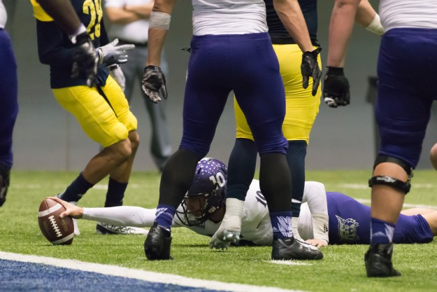 Weber State quarterback, Jadrian Clark, stretches toward the goal line late in the 3rd quarter of a game against Northern Arizona in the J. L. Walkup Skydome. This photo was taken with a Nikon D610 and 200-500mm f/5.6E at 480mm, f/6.3, ISO 8063, 1/500-second. It has been cropped and processed to taste in Adobe Lightroom. (Bill Ferris)
