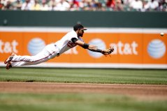 """""""Baltimore Orioles second baseman Robert Andino dives for a ball in the third inning of a baseball game against the Cleveland Indians Sunday, July 17, 2011 in Baltimore."""""""