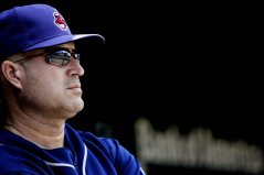 """""""Cleveland Indians manager Manny Acta looks on during the third inning of a baseball game against the Baltimore Orioles Sunday, July 17, 2011 in Baltimore."""""""