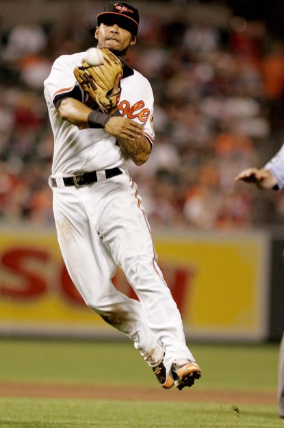 """""""Baltimore Orioles second baseman Robert Andino throws to first base in the eighth inning of a baseball game against the Boston Red Sox Monday, July 18, 2011 in Baltimore."""""""