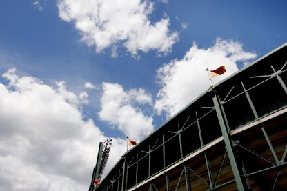 """""""World Series championship flags wave above the upper deck of Oriole Park at Camden Yards Monday, August 22, 2011 in Baltimore, Maryland."""""""