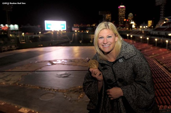 """""""2012 Olympic gold medal judo fighter, Kayla Harrison, poses with her gold medal in Fenway Park in Boston, Massachusetts Friday, December 14, 2012. Harrison was a guest speaker at the 2012 Boston Red Sox scholars holiday party."""