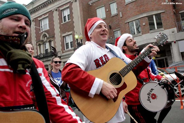 """""""Racers sign and play instruments as they run in Yulefest, a holiday themed 5K race in Cambridge, Massachusetts Sunday, December 2, 2012."""""""
