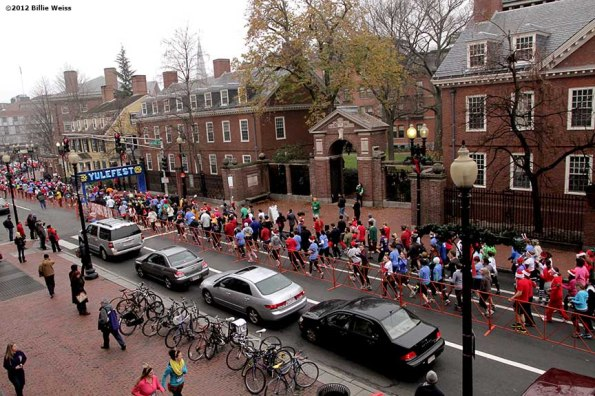 """""""Racers pass through the course start line during Yulefest, a holiday themed 5K race in Cambridge, Massachusetts Sunday, December 2, 2012."""""""