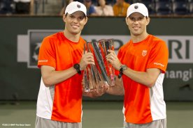 """""""Bob and Mike Bryan pose with the trophy after winning the men's doubles championship match Saturday, March 16, 2013 at the BNP Paribas Open in Indian Wells, California."""""""