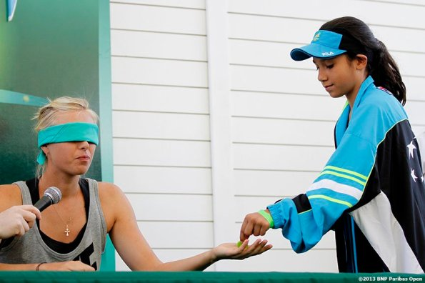 """""""Maria Sharapova participates in a blind taste test during a promotion for 'Sugarpova,' her line of gummy candies, at the Indian Wells Tennis Garden in Palm Springs, California on day one of the BNP Paribas Open Wednesday, March 6, 2013."""""""