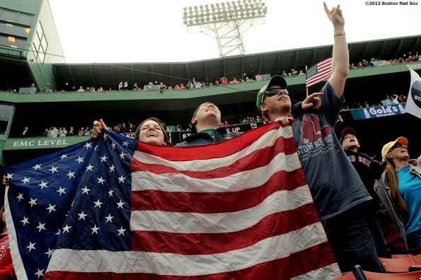 """""""Fans sing along to 'Sweet Caroline' during the first Boston Red Sox home game after the attacks on the 2013 Boston Marathon Saturday, April 20, 2013."""""""
