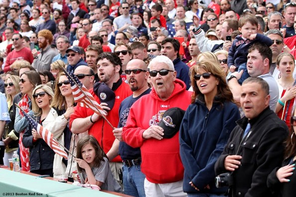 """""""Fans sing along to the National Anthem during a pre-game ceremony honoring the victims, first responders, and others involved in the attacks on the 2013 Boston Marathon Saturday, April 20, 2013."""""""