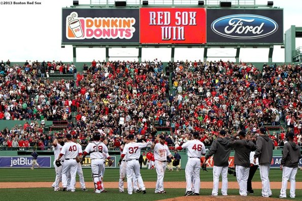 """""""The Boston Red Sox congratulate each other after defeating the Kansas City Royals Saturday, April 20, 2013. It was the first Red Sox home game since the attacks on the 2013 Boston Marathon."""""""