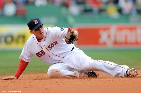 """""""Boston Red Sox shortstop Stephen Drew makes a diving stop on a ground ball during the ninth inning of a game against the Cleveland Indians at Fenway Park in Boston, Massachusetts Sunday, May 26, 2013."""""""