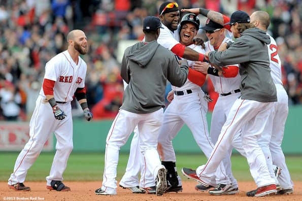 """""""Members of the Boston Red Sox mob center fielder Jacoby Ellsbury after hitting a walk-off single in the bottom of the ninth inning to defeat the Cleveland Indians 6-5 at Fenway Park in Boston, Massachusetts Sunday, May 26, 2013. The Red Sox came back from a 5-1 deficit in the eighth inning."""""""