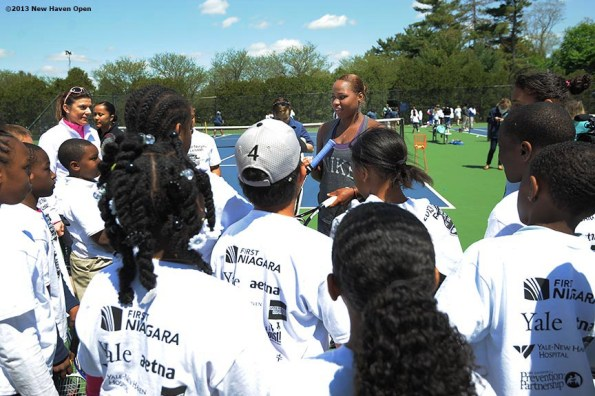"""""""Professional Tennis Player Taylor Townsend talks to kids Monday, May 13, 2013 at a free tennis lesson promotional event leading up to the New Haven Open Tennis Tournament at Yale University in New Haven, Connecticut. Over three hundred children from ten New Haven public schools attended the event."""""""