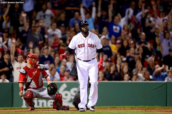 """""""Boston Red Sox designated hitter David Ortiz hits a two run home run during the sixth inning of a game against the Los Angeles Angels of Anaheim Saturday, June 8, 2013 at Fenway Park in Boston, Massachusetts."""""""